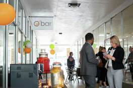 Community members mingle in the breezeway for Obar's tasting testing event back in May.