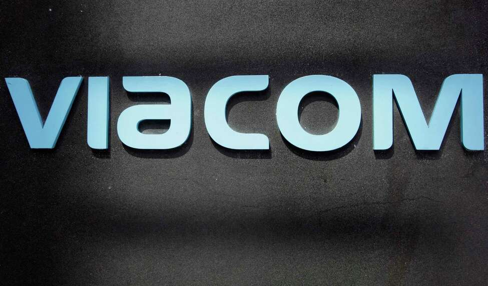 FILE - This Aug. 3, 2011, file photo, shows the Viacom logo at Viacom headquarters in New York. CBS and Viacom said Tuesday, Aug. 13, 2019, that they will reunite, bringing together their networks and the Paramount movie studio as traditional media giants bulk up to challenge streaming companies like Netflix. (AP Photo/Mark Lennihan, File)
