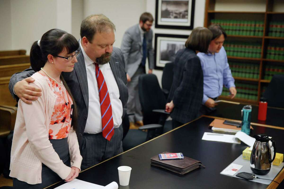Defense attorney Steven Wells puts his arm around defendant Elizabeth Hokoana, 31, as Judge Kristin Richardson declares a mistrial due to a hung jury in the case against Hokoana and her husband Marc Hokoana, Tuesday, Aug. 13, 2019. Elizabeth Hokoana was charged with first-degree assault for shooting activist Joshua Dukes at an inaguration protest in 2016 and Marc was charged with third-degree assault for using a