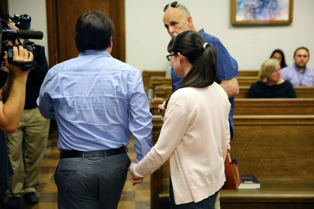 Elizabeth Hokoana and her husband Marc Hokoana leave the courtroom, Tuesday, Aug. 13, 2019, after Judge Kristin Richardson declared a mistrial due to a hung jury in the case against them. Elizabeth Hokoana was charged with first-degree assault for shooting activist Joshua Dukes at an inaguration protest in 2016 and Marc was charged with third-degree assault for using a