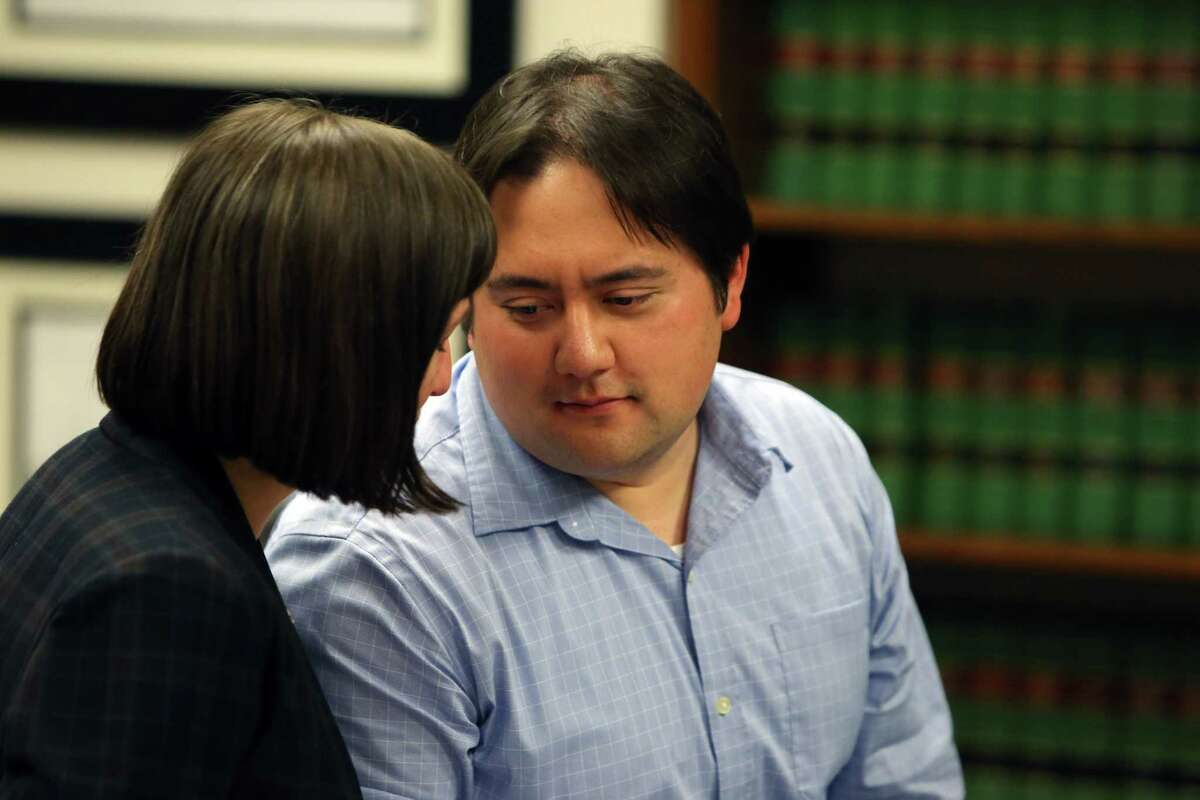 Marc Hokoana, 31, talks with his defense attorney Kim Gordon, after Judge Kristin Richardson declared a mistrial due to a hung jury in the case against him and his wife Elizabeth Hokoana, Tuesday, Aug. 13, 2019. Elizabeth Hokoana was charged with first-degree assault for shooting activist Joshua Dukes at an inaguration protest in 2016 and Marc was charged with third-degree assault for using a