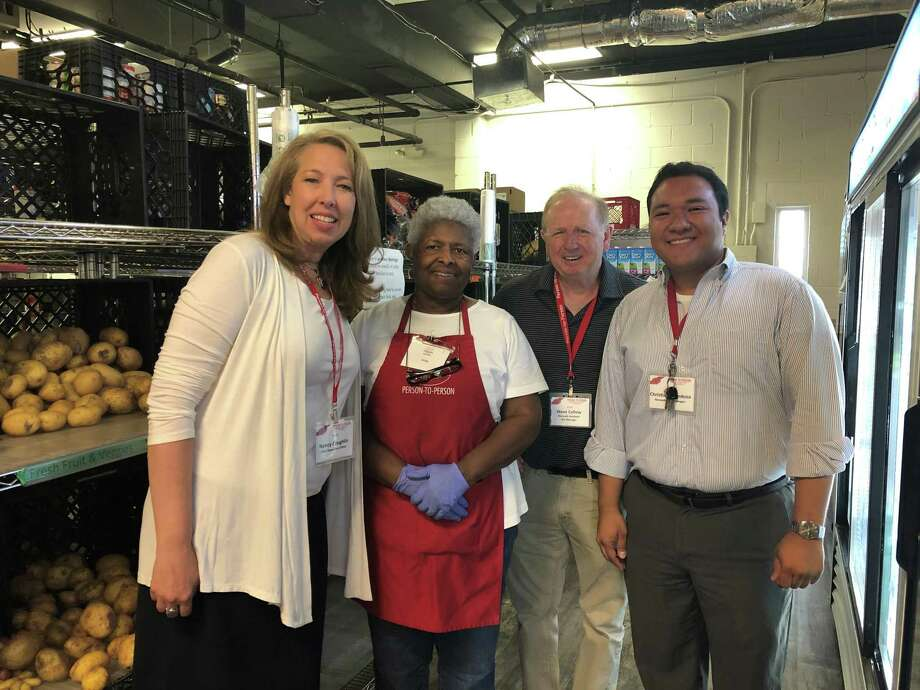 Nancy Coughlin, the new chief executive officer of Person-to-Person, (left), poses with volunteer Anita Osborne, Steve Callow, Norwalk Assistant Site Manager Christian Mendoza, Norwalk Site Manager (right), during a visit to the Norwalk site on Monday, August 5, 2019. Photo: Kelly Kultys / Hearst Connecticut Media / Norwalk Hour
