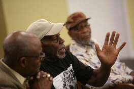 """Actor Danny Glover (center) speaks about the controversial mural, the """"Life of Washington"""" during a press conference at Third Baptist Church on Tuesday, August 13, 2019 in San Francisco, Calif."""