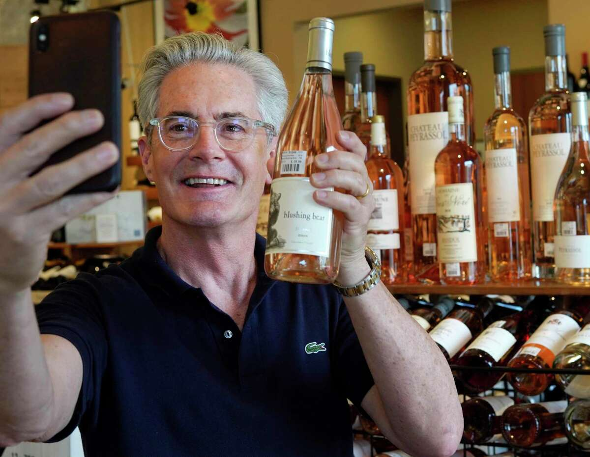 Kyle MacLachlan takes a selfie before an appearance for his Pursued by Bear Winery at Houston Wine Merchant.