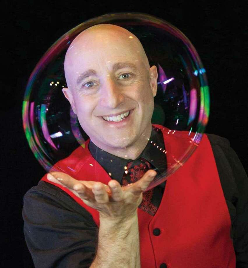 "Casey Carle, Connecticut's own Bubble Man, is bringing his show ""BubbleMania"" show back to the Ivoryton Playhouse. Photo: Ivoryton Playhouse / Contributed Photo"