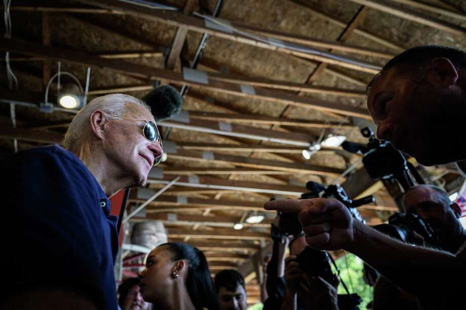 Former vice president Joe Biden listens as an Iowa voter greets him after speaking at the Iowa State Fair on Thursday, Aug. 8, 2019, in Des Moines, Iowa. Photo: Washington Post Photo By Salwan Georges / The Washington Post