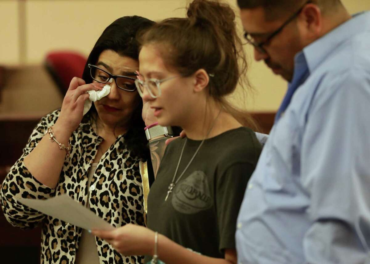 Christina Hernandez, left, mother of Noel Reyna, wipes away tears as Jaden Reyes, a cousin, reads a statement to Robert Allen, who was found guilty of murdering Noel Reyna. Allen accepted a sentence of 35 years Tuesday. Chris Quintero, Reyna's uncle, is at right.