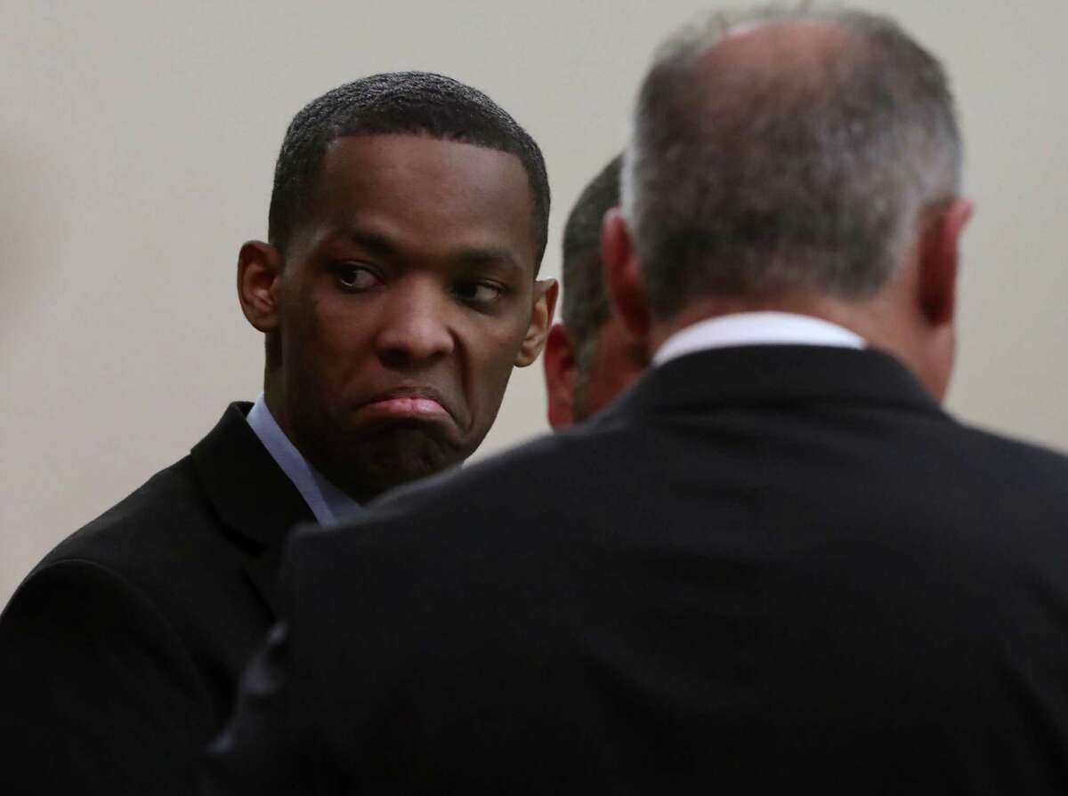 Robert Allen looks to family members following closing arguments Monday. A jury found him guilty of killing Noel Reyna.