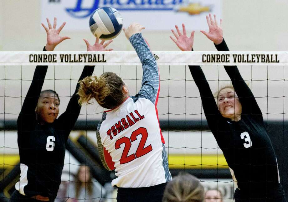 Conroe's T'lisha Kennedy (6) andAmanda Rivera (3) pressure a shot by Tomball middle blocker Faith Sabatier (22) on Tuesday. Photo: Jason Fochtman, Houston Chronicle / Staff Photographer / Houston Chronicle