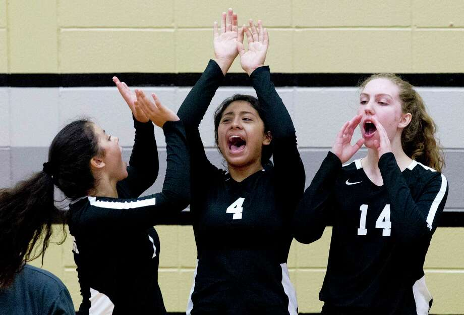 In this file photo, Conroe defensive specialist Leila Tamacas (4) reacts beside defensive specialist Jazzalyn Clark, left, and right side hitter Allison Vacek after a point in the second set of a non-district high school volleyball match at Conroe High School, Tuesday, Aug. 13, 2019, in Conroe. Photo: Jason Fochtman, Houston Chronicle / Staff Photographer / Houston Chronicle