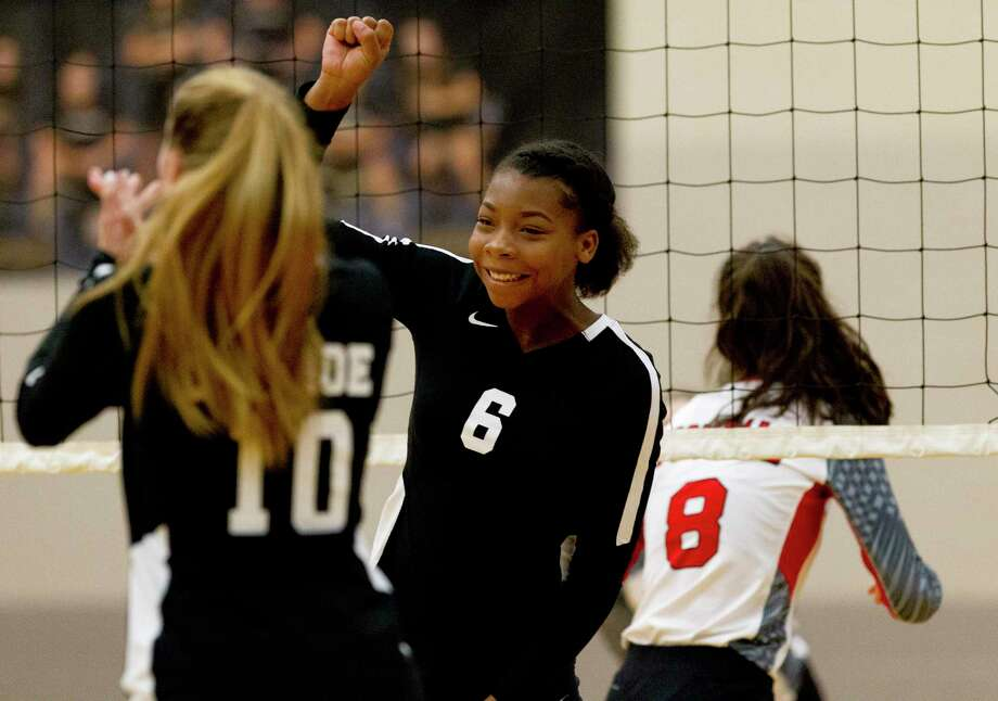 Conroe middle blocker T'lisha Kennedy (6), shown here in a match last month, had nine kills in a sweep of Klein Forest Tuesday night. Photo: Jason Fochtman, Houston Chronicle / Staff Photographer / Houston Chronicle