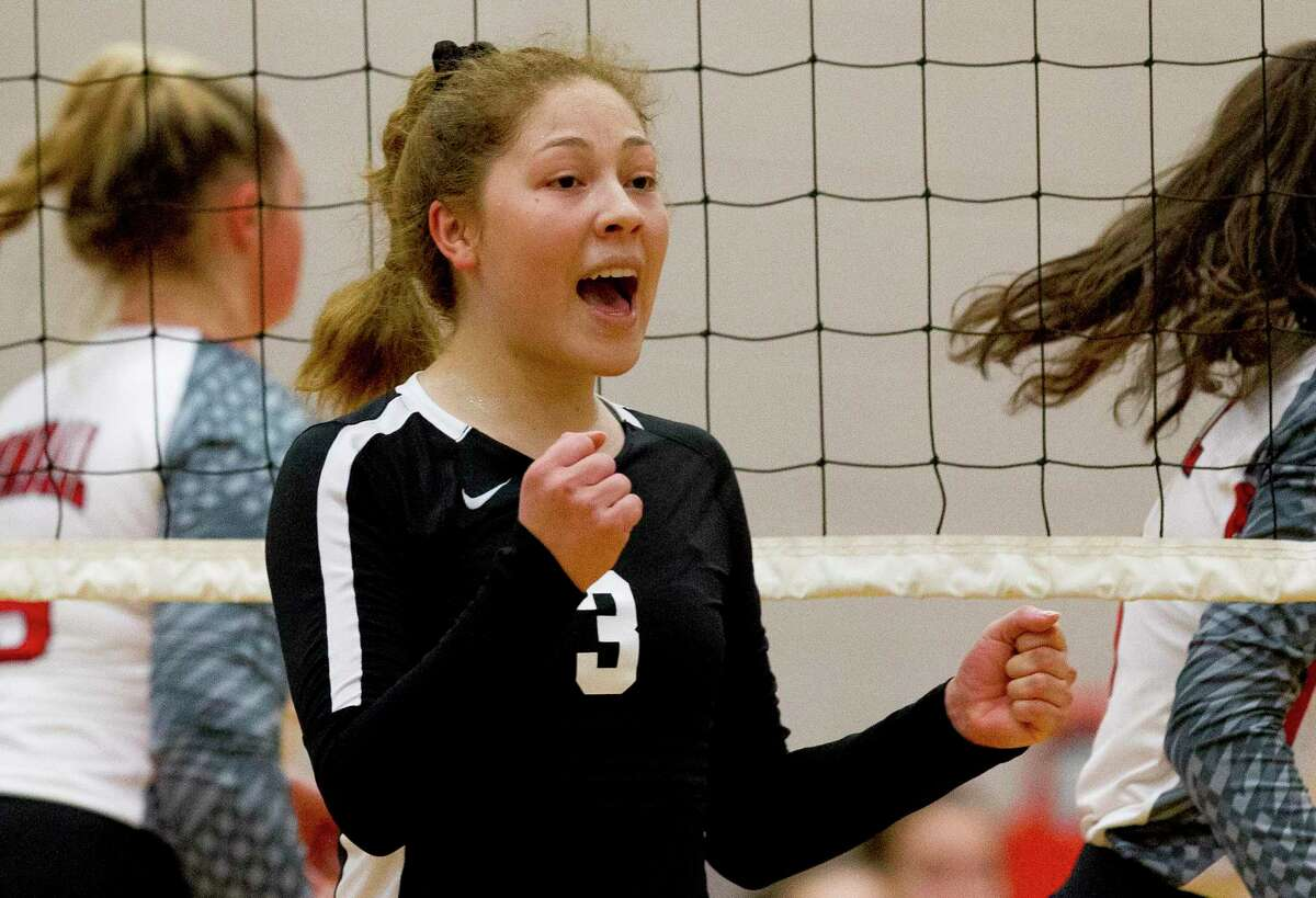 Conroe outside hitter Amanda Rivera (3) reacts after scoring a point in the third set of a non-district high school volleyball match at Conroe High School, Tuesday, Aug. 13, 2019, in Conroe.
