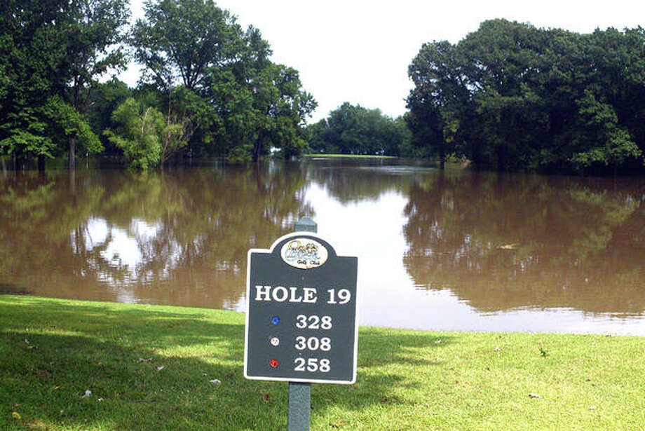 Water covers hole No. 19 at Oak Brook Golf Club in Edwardsville on Monday afternoon after heavy rain on Sunday night forced the closing of the East Nine (holes 19-27). Oak Brook owner Larry Suhre said the course got 4.5 inches of rain on Sunday and another 0.7 inches on Monday while nearby Hamel got 6.7 inches on Sunday. Suhre estimates it will be 10 to 12 days before the East Nine is reopened. Heavy rains continued early Tuesday morning, leaving hundreds of Edwardsville residents without power. Photo: Scott Marion | The Intelligencer