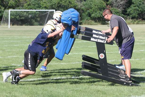 The Bad Axe High School varsity football team holds a practice Tuesday afternoon.