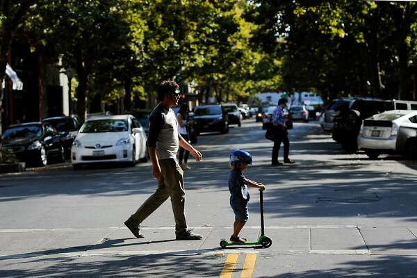 People cross University Ave. in Palo Alto, CA Friday, August 7, 2015.