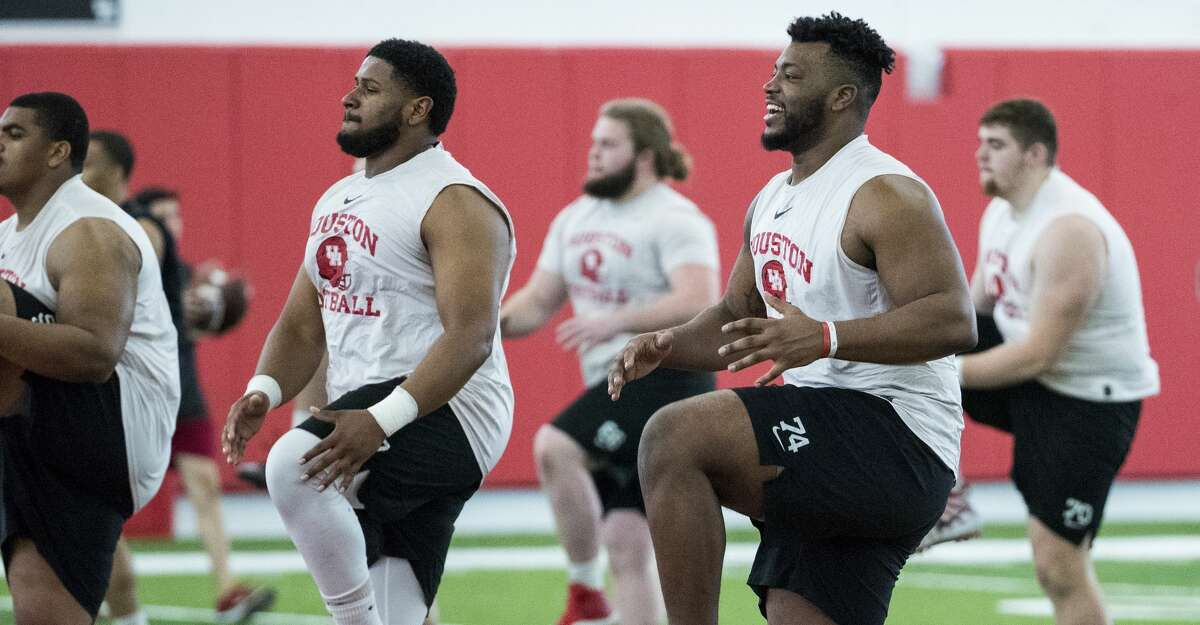PHOTOS:College football players from the Houston area to watch in 2019 Houston offensive linemen Keenan Murphy, left, and Josh Jones (74) warm up during the first day of spring practice on Tuesday, March 19, 2019, in Houston. >>>Here are 10 college football players from the Houston area to keep an eye on for the 2019 season ...
