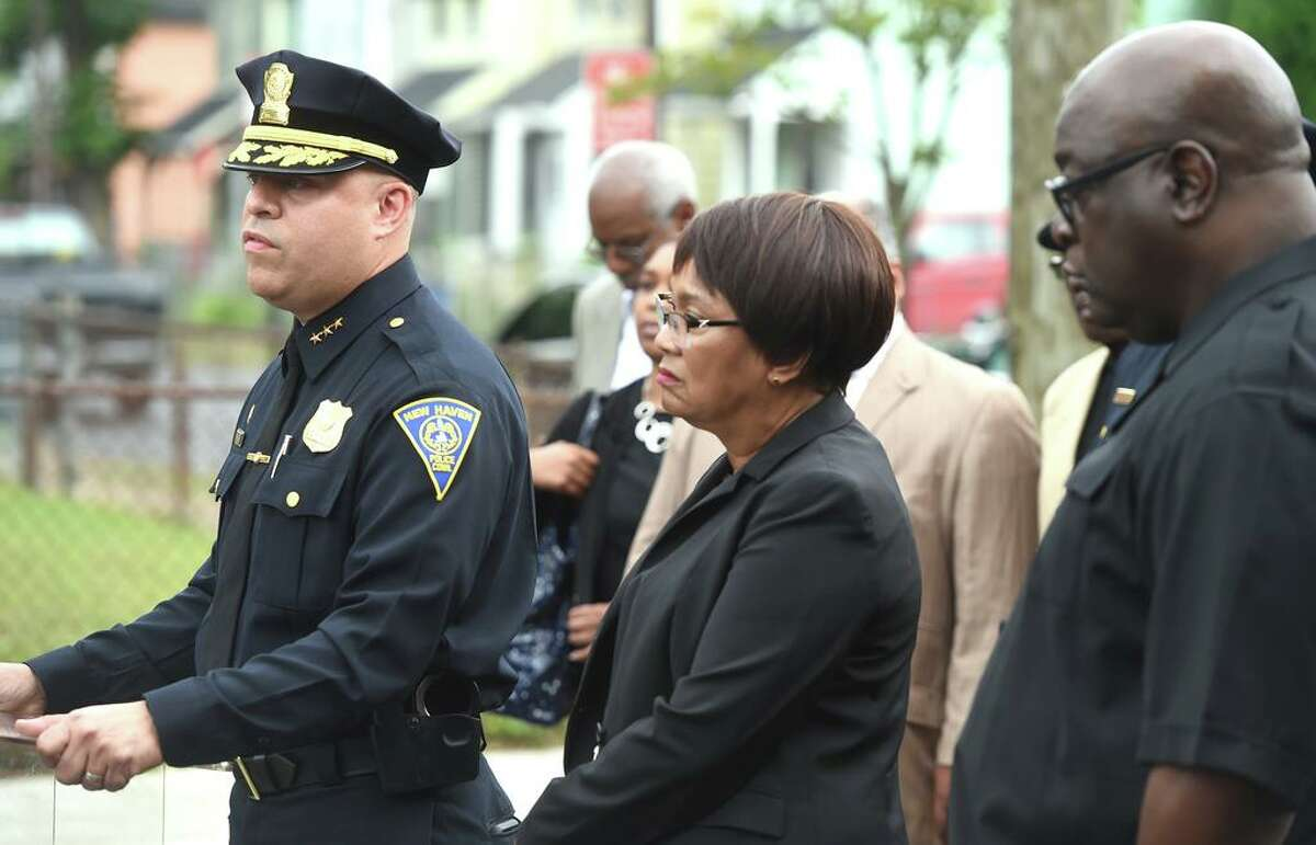 New Haven Police Chief Otoniel Reyes (left) speaks to the press on Henry Street in New Haven on August 13, 2019 following the shooting of New Haven Police Captain Anthony Duff the previous night responding to a shooting while off-duty.