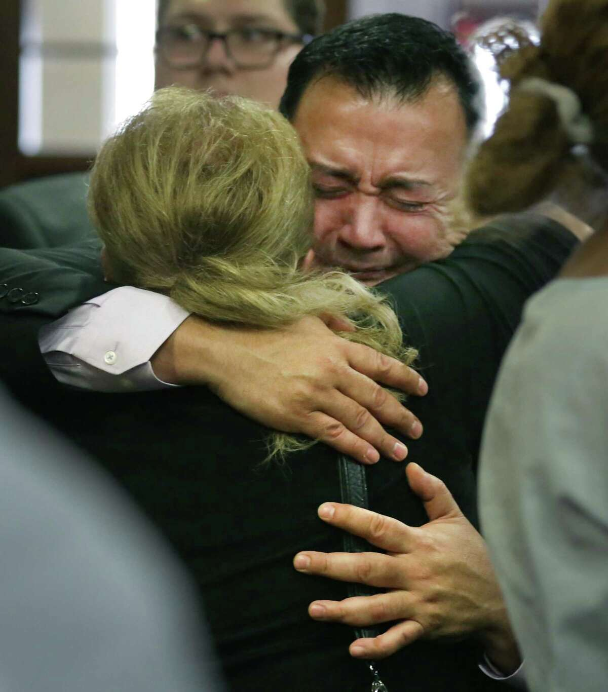 Gene Vargas, father of Jared Vargas, is embraced by neighbor Yolanda Martinez following the guilty verdict Tuesday against Ernesto Esquivel-Garcia, who killed the younger Vargas last year.