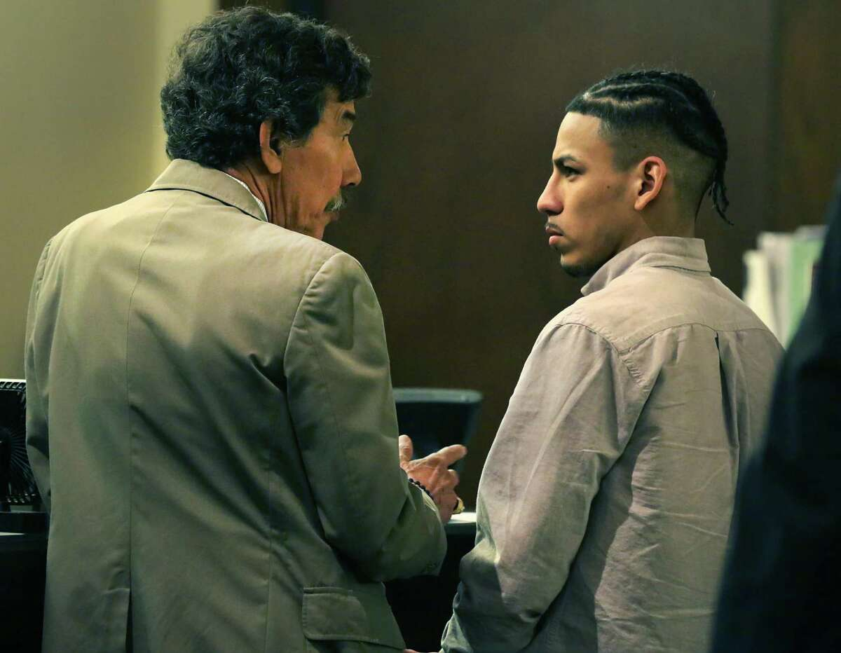 Ernesto Esquivel-Garcia, right, listens to his lawyer George Shaffer after he was found guilty of murder for killing Jared Vargas, 20, last year.