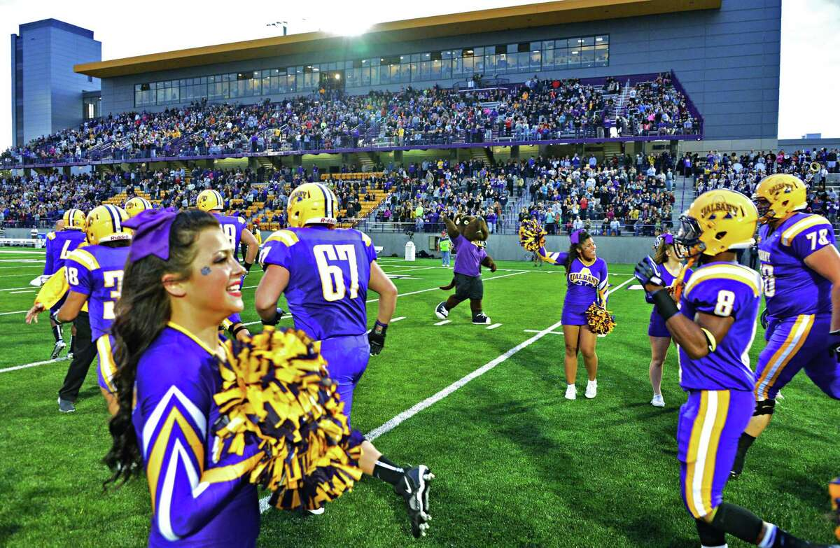 Cheerleaders welcome players onto the new Bob Ford field in front of a packed stadium as UAlbany football plays its home opener against Rhode Island Saturday Sept. 14, 2013. (John Carl D'Annibale / Times Union)