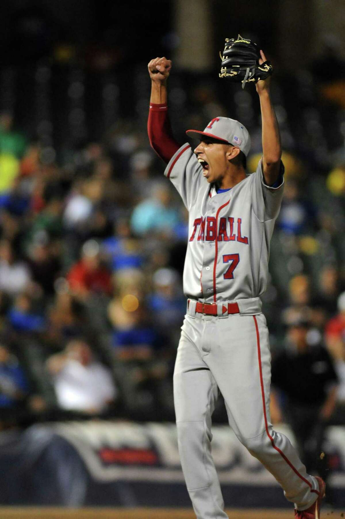 Tomball product Robert Dugger celebrates his strikeout to finish off the Corpus Christi Moody Trojans in the 2013 Class 4A UIL State Baseball Championship final at Dell Diamond in Round Rock..