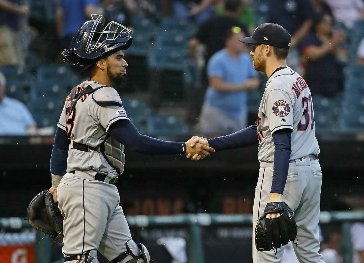 CHICAGO, ILLINOIS - AUGUST 13: Collin McHugh #31 (R) and Robinson Chirinos #28 of the Houston Astros celebrate a win against the Chicago White Sox at Guaranteed Rate Field on August 13, 2019 in Chicago, Illinois. The Astros defeated the White Sox 6-2. (Photo by Jonathan Daniel/Getty Images)