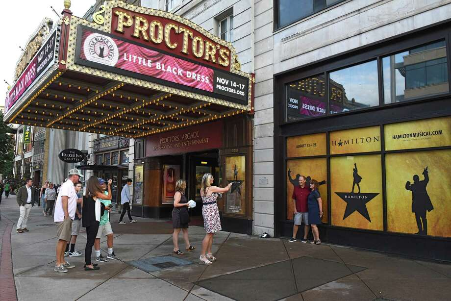"""People take photos in front of """"Hamilton"""" posters before the opening night performance of """"Hamilton"""" at Proctors Theatre on Tuesday, Aug. 13, 2019 in Schenectady, N.Y. (Lori Van Buren/Times Union) Photo: Lori Van Buren, Albany Times Union / 20047648A"""