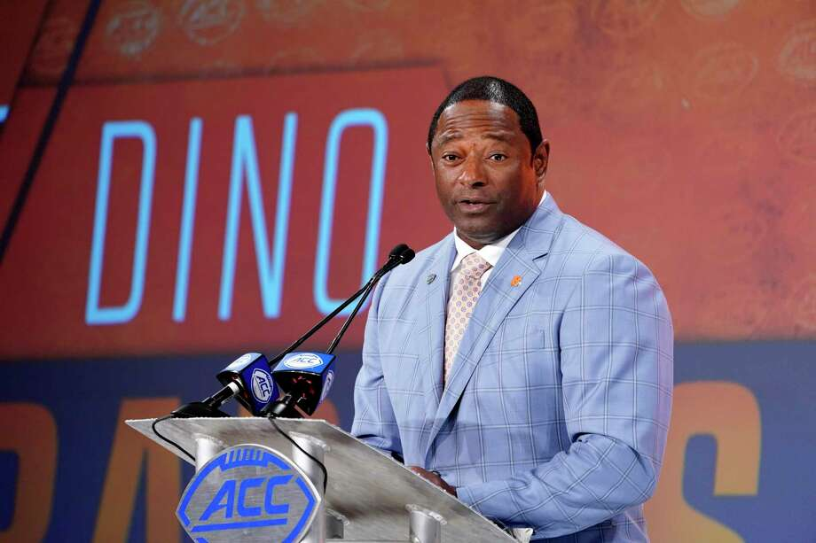 FILE - In this July 17, 2019, file photo, Syracuse head coach Dino Babers speaks during the Atlantic Coast Conference NCAA college football media day in Charlotte, N.C. Babers begins his fourth season at Syracuse with one main goal _ to prove that last season was no fluke.  Syracuse finished 10-3 in 2018, second to national champion Clemson in the Atlantic Coast Conference's tough Atlantic Division, and was No. 15 in the AP's final poll.(AP Photo/Chuck Burton, File) Photo: Chuck Burton / Copyright 2019 The Associated Press. All rights reserved