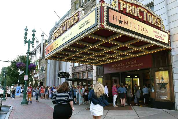 """A long line is seen going into Proctors Theatre as people arrive for the opening night performance of """"Hamilton"""" on Tuesday, Aug. 13, 2019 in Schenectady, N.Y. (Lori Van Buren/Times Union)"""