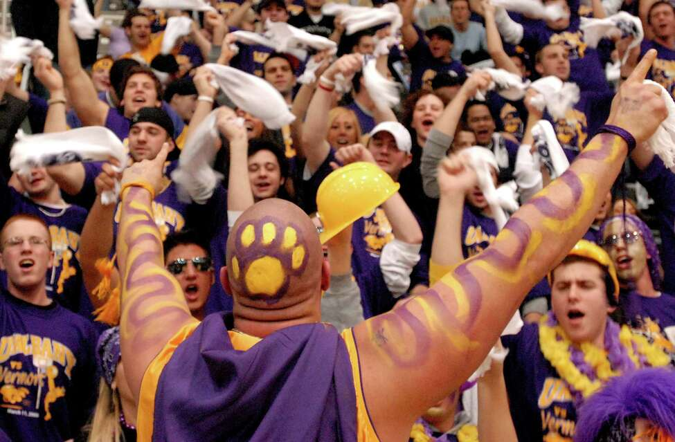 UAlbany fan Adam Thorpe, center, leads students in a cheer during their team's America East Championship basketball game against Vermont on Saturday, March 11, 2006, at University at Albany. UAlbany won 80-67.