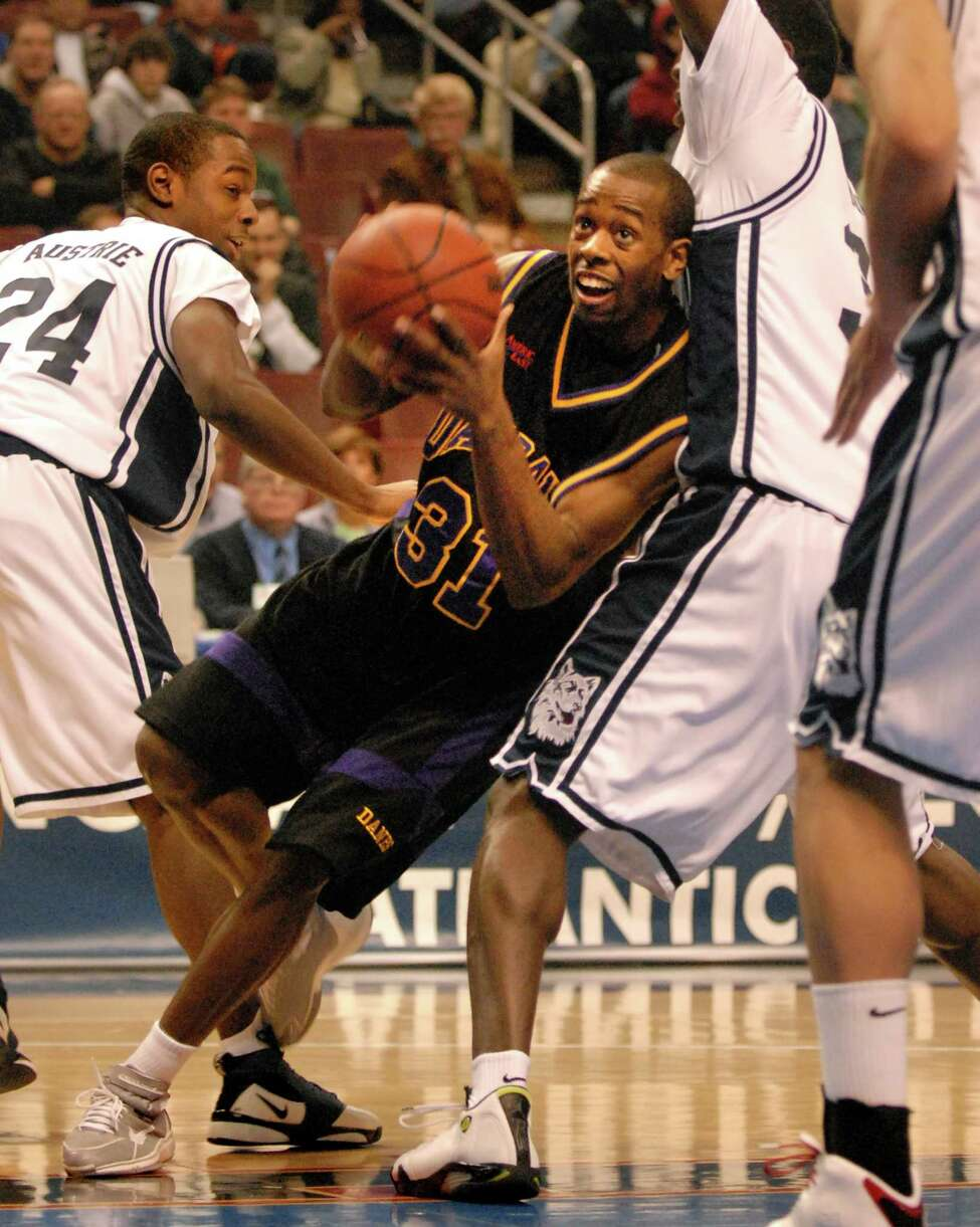 UAlbany's Jamar Wilson battles UConn during their NCAA first round game on Friday, March 17, 2006, at the Wachovia Center in Philadelphia, Penn. UConn won 72-59. (Cindy Schultz / Times Union)