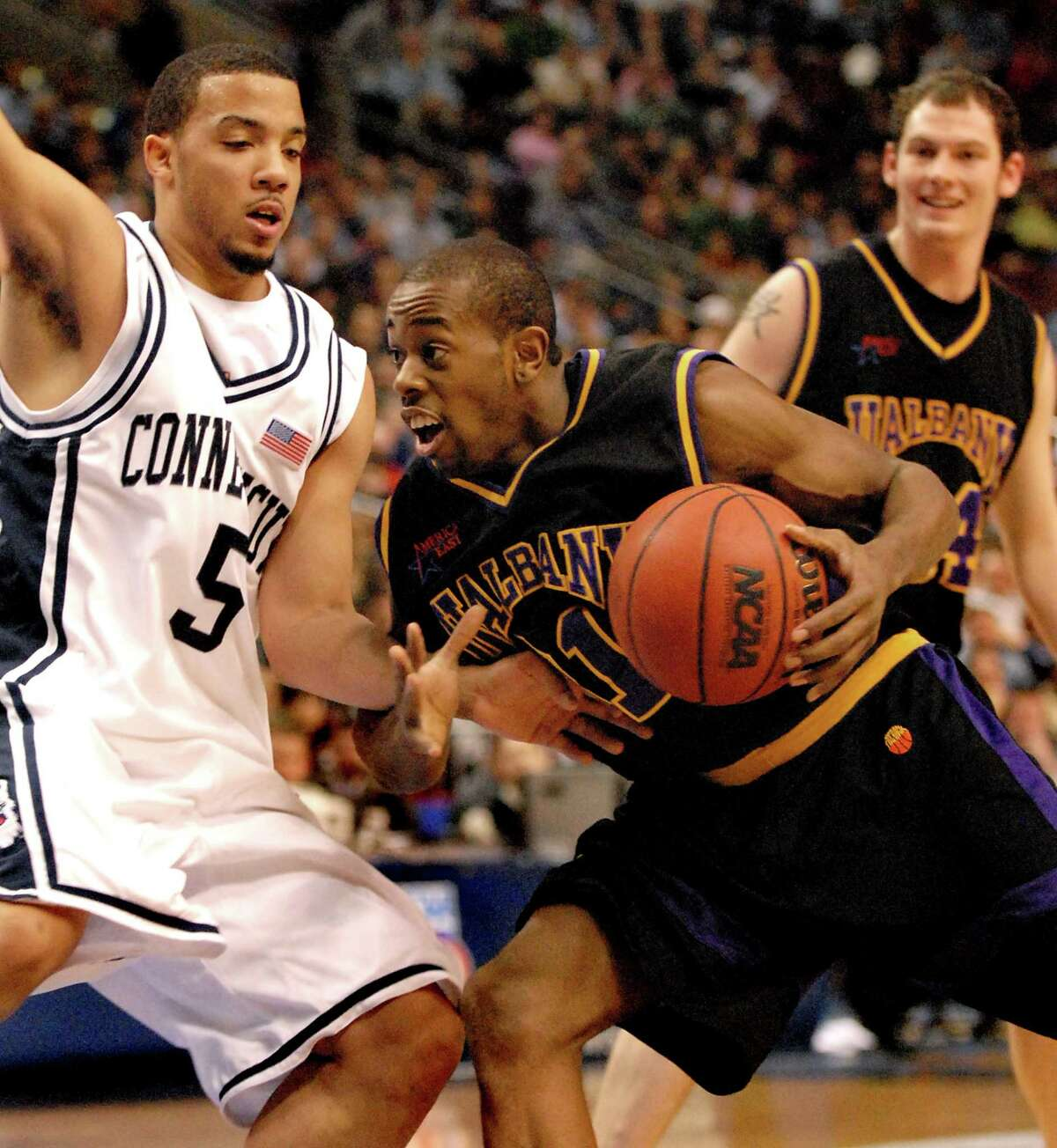 UAlbany's Jamar Wilson drives past UConn's Marcus Williams,  during their NCAA first round game on Friday, March 17, 2006, at the Wachovia Center in Philadelphia, Penn. UConn won 72-59. (Cindy Schultz / Times Union)