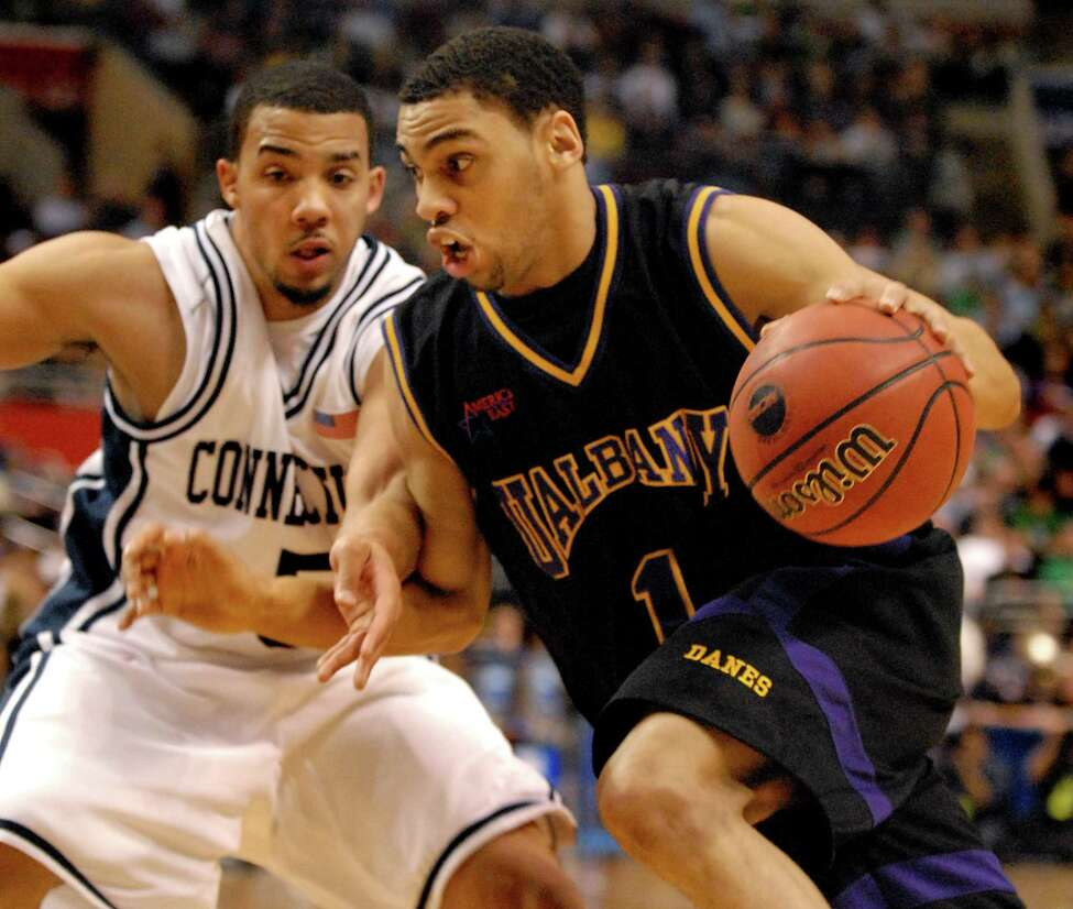 UAlbany's Jason Siggers drives past UConn's Marcus Williams during an NCAA first round game Friday, March 17, 2006, at the Wachovia Center in Philadelphia, Penn. UConn won 72-59. (Cindy Schultz / Times Union)