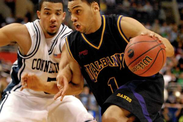 Times Union staff photo by Cindy Schultz -- UAlbany's Jason Siggers (1), right, drives past UConn's Marcus Williams (5), left, during their NCAA first round game against UConn on Friday, March 17, 2006, at the Wachovia Center in Philadelphia, Penn. University of Connecticut wins 72-59.