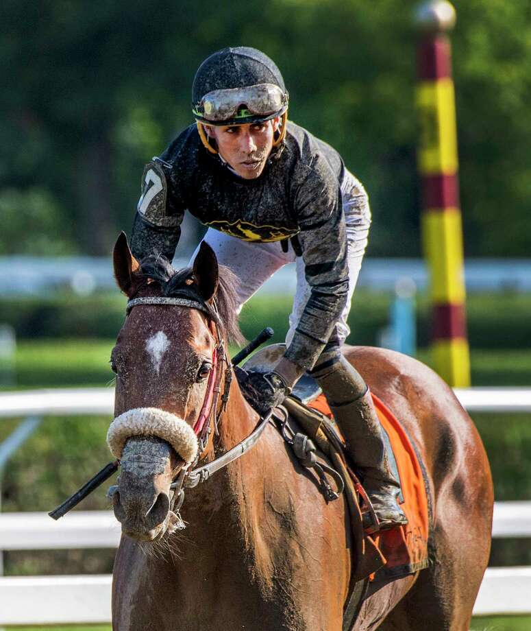 Ben Raison with jockey Irad Ortiz Jr. heads back to the winnerA•s circle after winning the 6th running of The Tale of the Cat at the Saratoga Race Course Friday Aug. 9, 2019 in Saratoga Springs, N.Y.   Photo Special to the Times Union by Skip Dickstein