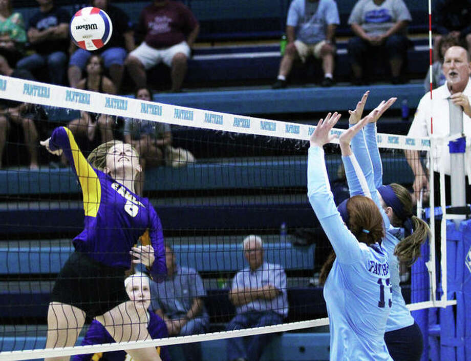 Civic Memorial's Sydney Henke (left) hits over a double block put up by the Jersey Panthers in a Mississippi Valley Conference volleyball match last season at Havens Gym in Jerseyville. The 6-foot senior is back to lead the Eagles after earning first-team All-MVC honors as a junior. Photo: Greg Shashack / The Telegraph