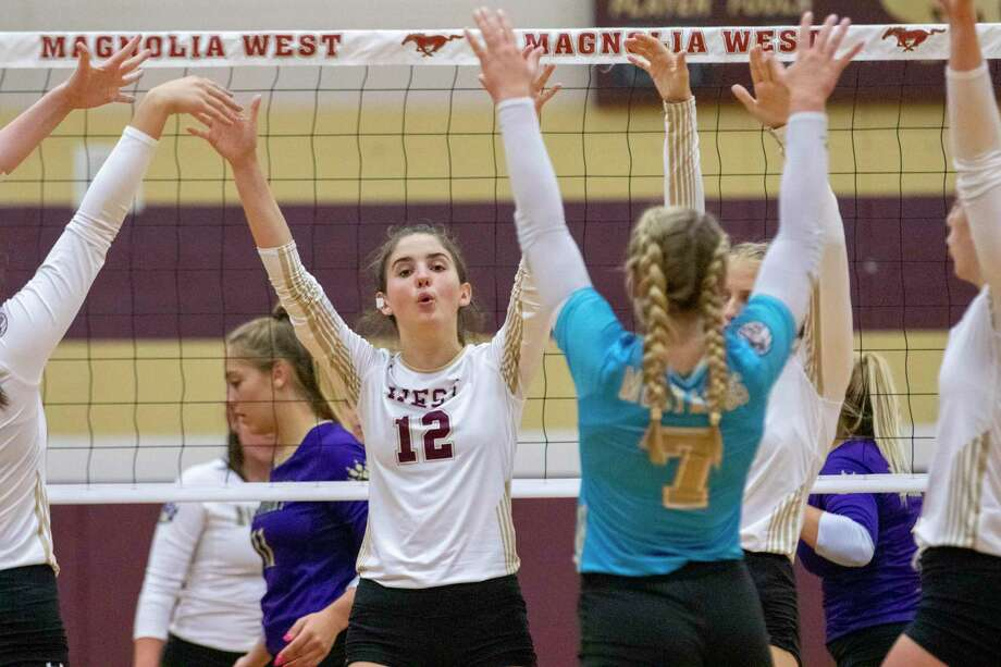 Magnolia West celebrates after scoring during a non-district volleyball match Tuesday at Magnolia West High School in Magnolia. Photo: Cody Bahn, Houston Chronicle / Staff Photographer / © 2019 Houston Chronicle