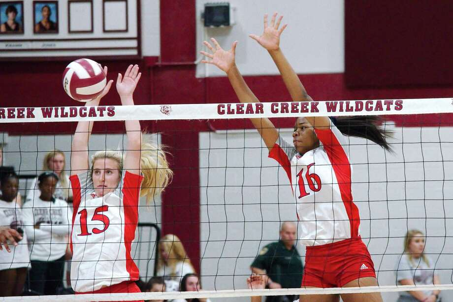 Dawson's Madison Deslatte (15) and Aliyah McDonald (16), shown in a match earlier this year against Clear Creek, were instrumental Monday night in the Lady Eagles' sweep of the Lady Wildcats. Photo: Kirk Sides / Staff Photographer / © 2019 Kirk Sides / Houston Chronicle