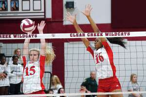 Dawson's Madison Deslatte (15) and Aliyah McDonald (16) go high to block a shot against Clear Creek Tuesday night.