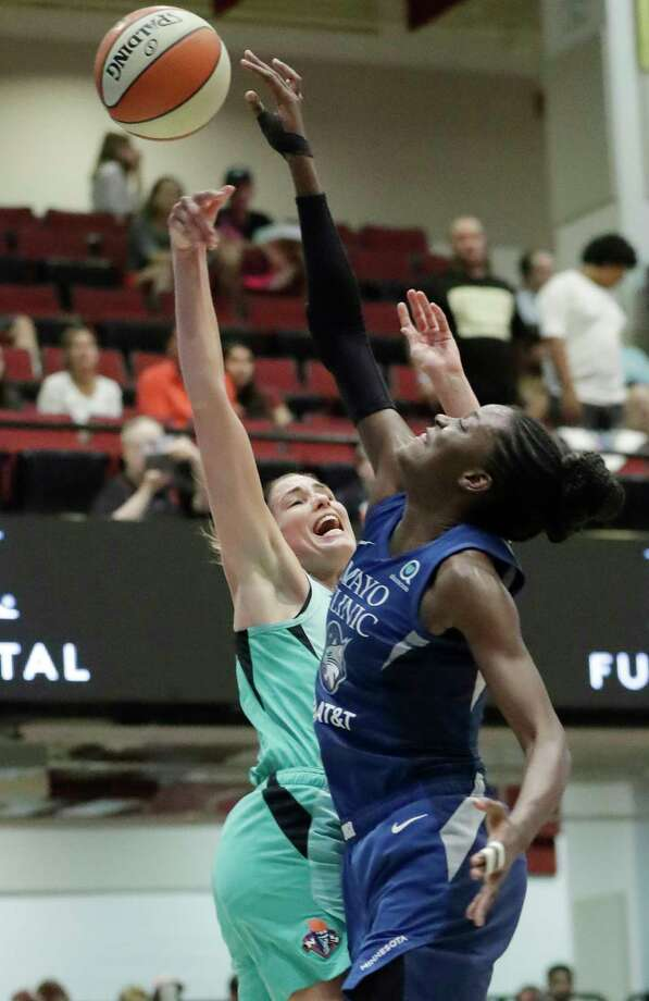 Minnesota Lynx center Temi Fagbenle, right, tips the ball away from New York Liberty forward Rebecca Allen during the first half of a WNBA basketball game Tuesday, Aug. 13, 2019, in White Plains, N.Y. (AP Photo/Kathy Willens) Photo: Kathy Willens / Copyright 2019 The Associated Press. All rights reserved.
