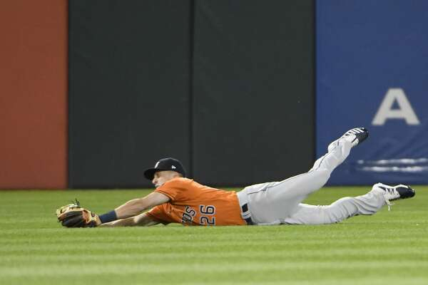 CHICAGO, ILLINOIS - AUGUST 13: Myles Straw #26 of the Houston Astros makes a catch on a ball hit by Matt Skole #32 of the Chicago White Sox during the fourth inning of game two of a doubleheader at Guaranteed Rate Field on August 13, 2019 in Chicago, Illinois. (Photo by David Banks/Getty Images)