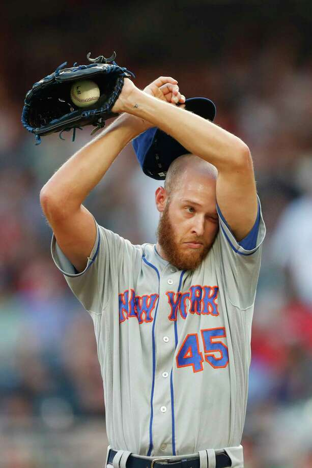 New York Mets starting pitcher Zack Wheeler (45) wipes his face between batters in the first inning of a baseball game against the Atlanta Braves Tuesday, Aug. 13, 2019, in Atlanta. (AP Photo/John Bazemore) Photo: John Bazemore / Copyright 2019 The Associated Press. All rights reserved