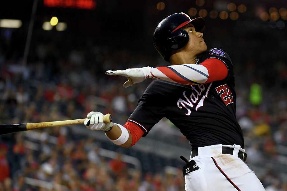 Washington Nationals outfielder Juan Soto (22) slams a solo home run in the fourth inning against the Cincinnati Reds at Nationals Park August 13, 2019. Photo: Washington Post Photo By Katherine Frey / The Washington Post