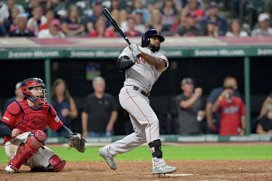 CLEVELAND, OHIO - AUGUST 13: Jackie Bradley Jr. #19 of the Boston Red Sox hits a solo homer to take the lead during the tenth inning against the Cleveland Indians at Progressive Field on August 13, 2019 in Cleveland, Ohio. (Photo by Jason Miller/Getty Images) Photo: Jason Miller / 2019 Getty Images