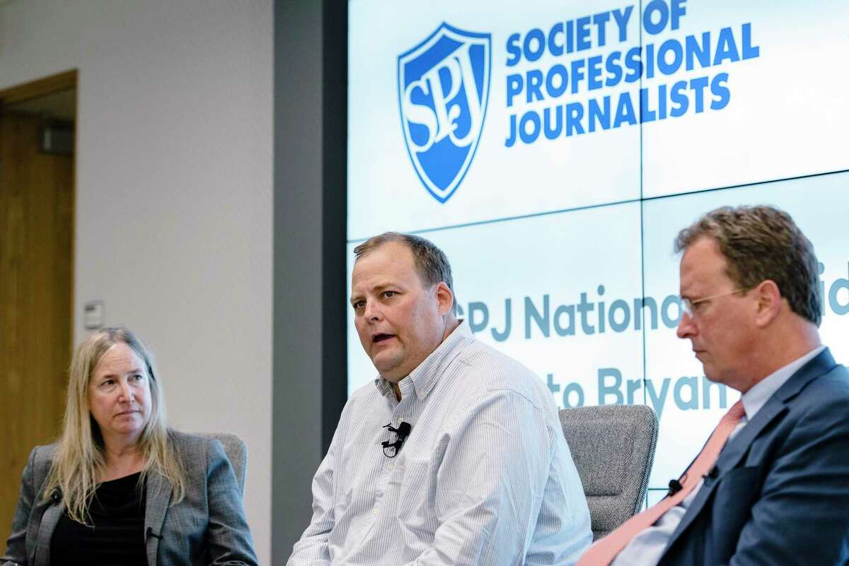 Freelance journalist Bryan Carmody, center, whose home was raided by the San Francisco Police Department, speaks during a Q&A with the Society of Professional Journalists president J. Alex Tarquinio, left, and his lawyer Thomas Burke, in San Francisco, Calif, on Tuesday, Aug. 13, 2019.