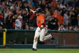SAN FRANCISCO, CALIFORNIA - AUGUST 09: Stephen Vogt #21 of the San Francisco Giants celebrates as he rounds third base after hitting a two-run home run in the bottom of the sixth inning against the Philadelphia Phillies at Oracle Park on August 09, 2019 in San Francisco, California. (Photo by Lachlan Cunningham/Getty Images)