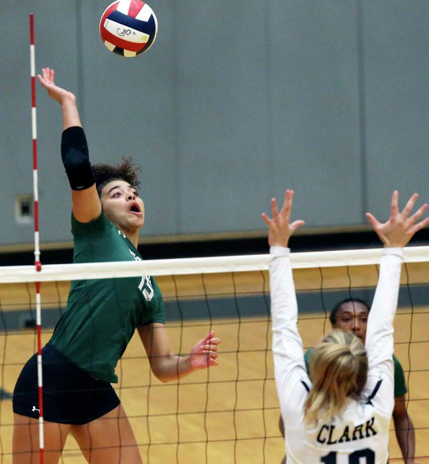 Naya Anderson goes up for a kill for the Rattlers as Reagan hosts Clark in volleyball at Littleton Gym on August 13, 2019. Photo: Tom Reel, Staff / Staff Photographer / 2019 SAN ANTONIO EXPRESS-NEWS