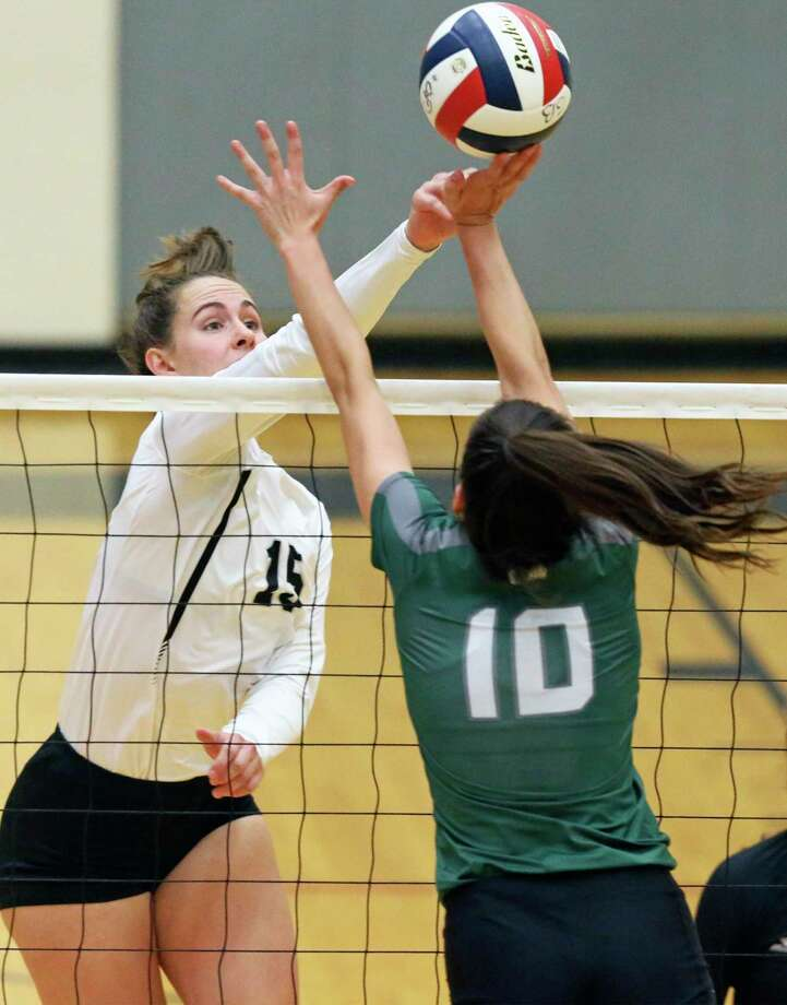 Grace Gibson pushes the ball for the Cougars over Julia Aleman as Reagan hosts Clark in volleyball at Littleton Gym on August 13, 2019. Photo: Tom Reel, Staff / Staff Photographer / 2019 SAN ANTONIO EXPRESS-NEWS