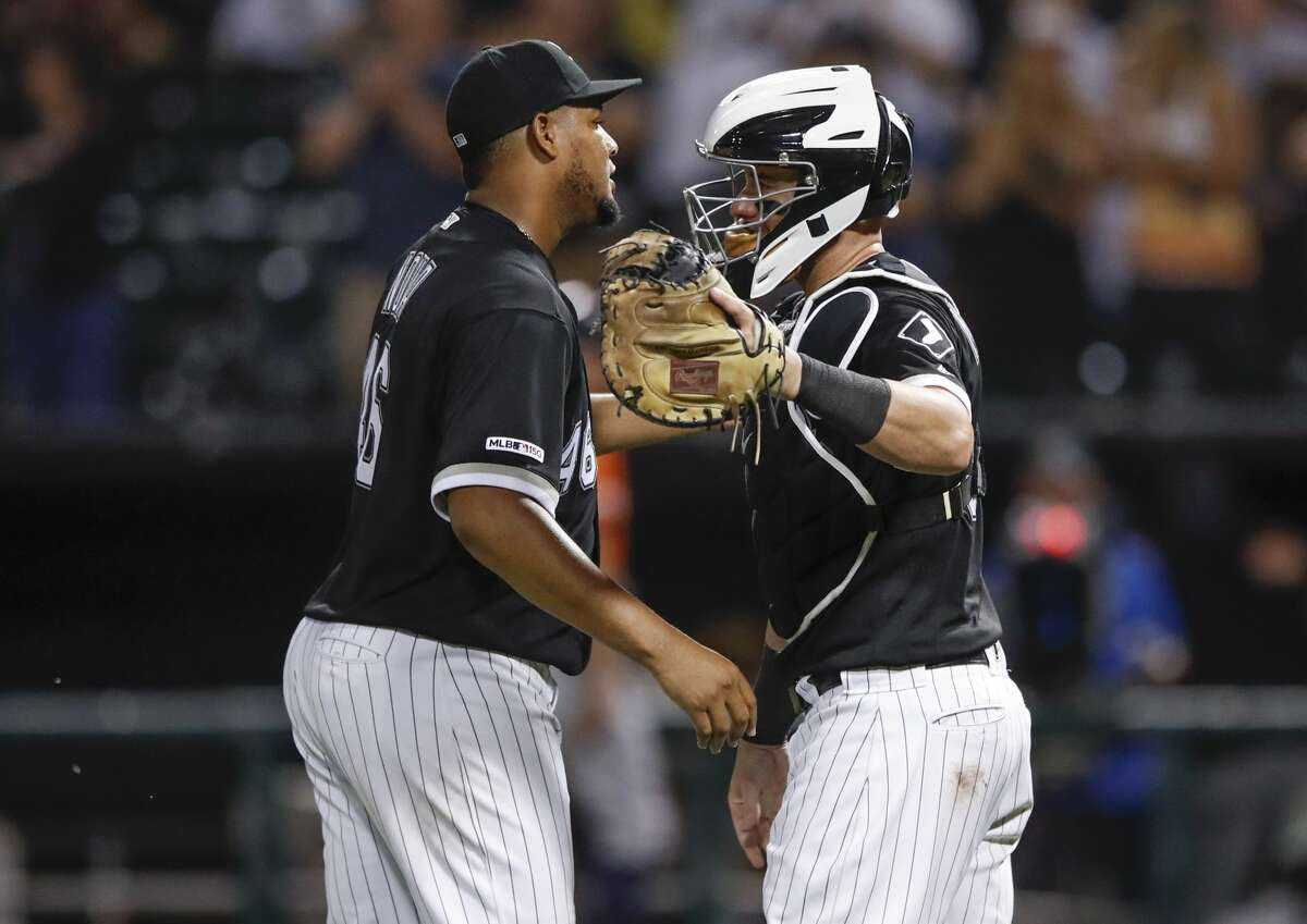 Chicago White Sox's Ivan Nova, left, celebrates with James McCann, right, after the White Sox defeated the Houston Astros 4-1 in the second baseball game of a doubleheader Tuesday, Aug. 13, 2019, in Chicago. (AP Photo/Kamil Krzaczynski)