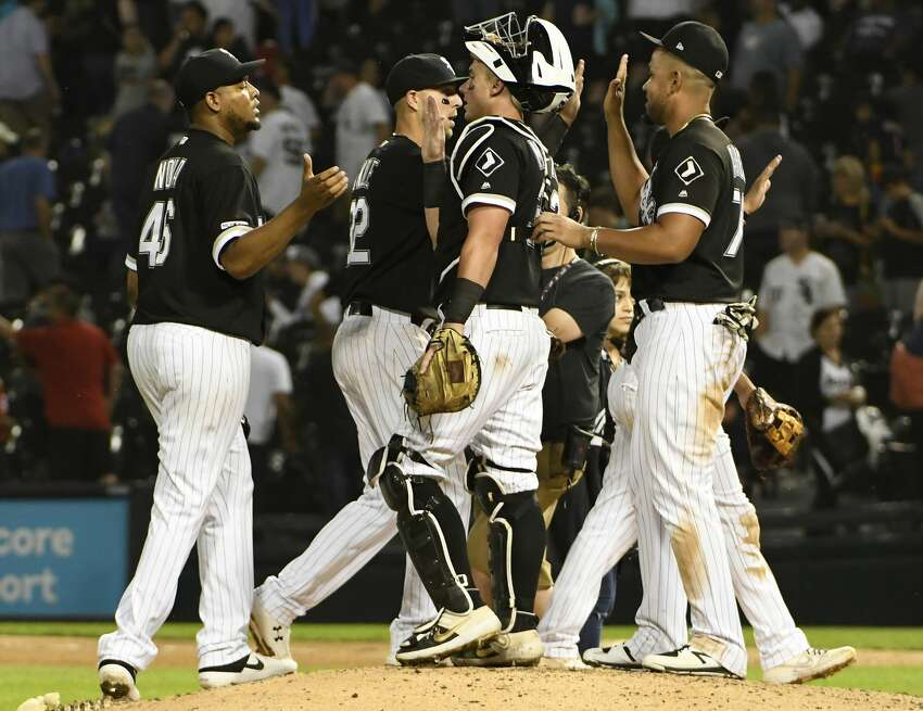 CHICAGO, ILLINOIS - AUGUST 13: The Chicago White Sox celebrate their 4-1 win against the Houston Astros in game two of a doubleheader at Guaranteed Rate Field on August 13, 2019 in Chicago, Illinois. (Photo by David Banks/Getty Images)